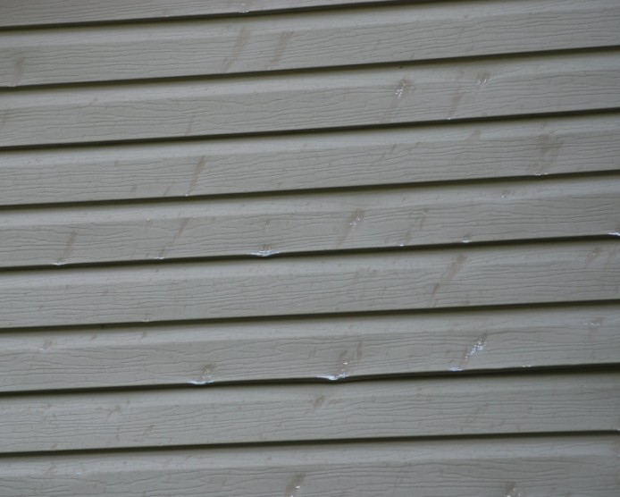5 worst mistakes of historic homeowners part 3 siding by for Hail damage vinyl siding